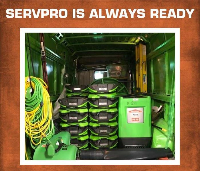 "The back of a SERVPRO truck full of equipment and ready to go, with the words ""SERVPRO is Always Ready"" across the top"