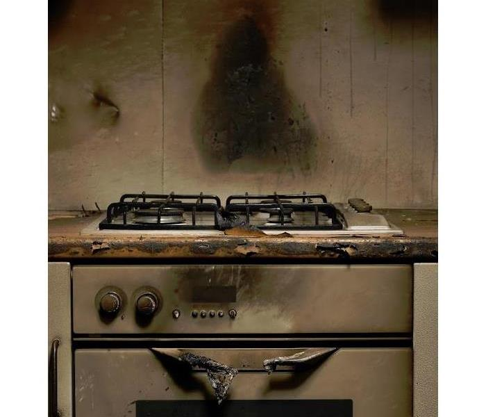 fire damaged oven in kitchen