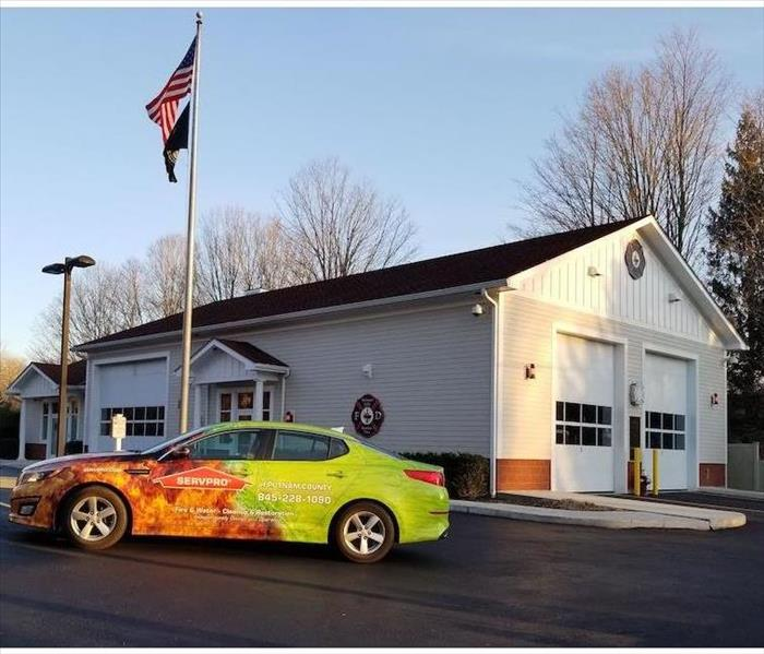 SERVPRO vehicle parked in front of fire station