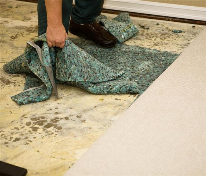 water damaged carpet being removed